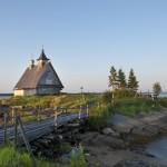 Old wooden church on sunrise near White Sea, Karelia